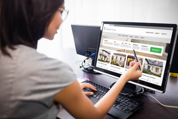 Woman searching for properties online