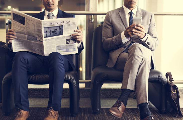 two-men-read-news
