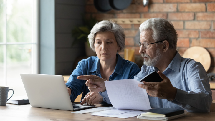 Older couple looking at their finances
